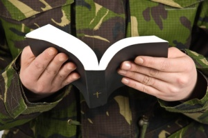 Army soldier reading bible