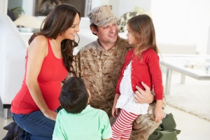 Family Greeting Military Father Home On Leave