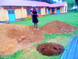 2017-7-19_SISTER IRENE LOOKING AT THE NEW BOREHOLE BEING DUG AT KIBACHENJE GBF CHURCH.WE PRAY AND HOPE TO FINISH IT AS GOD ENABLES